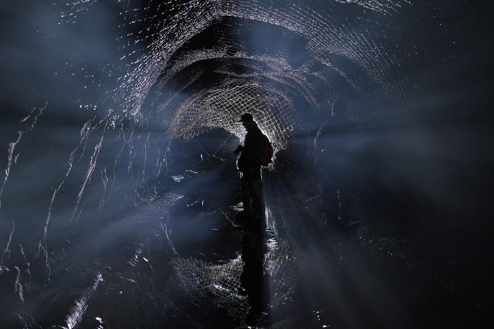 Man surveying mine